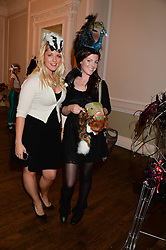 Left to right, GABBY WICKHAM and NATALIE ELLNER at the The Animal Ball – Masking Up Moment held at the Quintessentially Ballrooms, 29 Portland Place, London W1 on 10th June 2013.