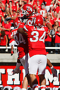 Utah runningback Eddie Wide (36) is hoisted up by his teammates Brad Clifford (84) and Shawn Asiata (34) after scoring against UNLV in the 4th quarter of an NCAA college football game at Rice-Eccles Stadium, Saturday, Sept. 11, 2010, in Salt Lake City, Utah. Utah defeated UNLV 38-10.  (AP Photo/Colin E. Braley)
