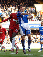 Photo: Ashley Pickering.<br />Ipswich Town v Southend United. Coca Cola Championship. 10/03/2007.<br />Alan Lee of Ipswich (R) wins the ball from Efe Sodje of Southend
