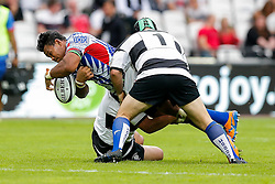 Samoa Number 8 Ofisa Treviranus is tackled by Barbarians Prop Benn Robinson (Waratahs & Australia) - Mandatory byline: Rogan Thomson/JMP - 07966 386802 - 29/08/2015 - RUGBY UNION - The Stadium at Queen Elizabeth Olympic Park - London, England - Barbarians v Samoa - International Friendly.