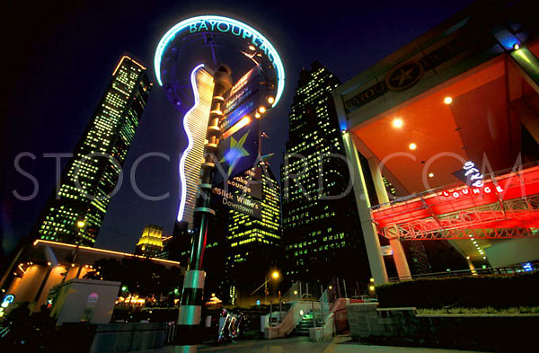 Stock photo of the downtown Houston Skyline at Night with Bayou Place