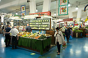 Interior of Coventry Market with fruit and vegetable stall in the UK City of Culture 2021 on 23rd June 2021 in Coventry, United Kingdom. The market is an indoor market with vendors for fruit, vegetables, meat, fish, artisanal items & secondhand goods. There has een a market on this site since 1958. The UK City of Culture is a designation given to a city in the United Kingdom for a period of one year. The aim of the initiative, which is administered by the Department for Digital, Culture, Media and Sport. Coventry is a city which is under a large scale and current regeneration.