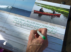 October 13, 2016 - Dana Point, California, USA - A visitor to the memorial for Robert Nealy signs the guest book at Dohney State Beach in Dana Point, California, October 13, 2016...Friends and family gathered for a memorial for Nearly who is credited with inventing the Velco surf leach in 1973...Nealy lost a long battle with lymphoma on September 1, 2016...(Photo by Jeff Gritchen, Orange County Register/SCNG) (Credit Image: © Jeff Gritchen/The Orange County Register via ZUMA Wire)