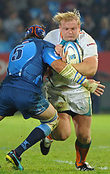 PRETORIA, South Africa, 28 May 2011. Adriaan Strauss (C) of the Cheetahs is tackled by Victor Matfield (Capt) of the Bulls during the Super15 Rugby match between the Bulls and the Cheetahs at Loftus Versfeld in Pretoria, South Africa on 28 May 2011..Photographer : Anton de Villiers / SPORTZPICS
