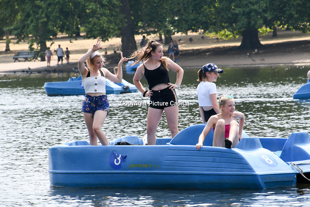 UK Weather: People boating in Hype park as heatwave continues in London, UK. July 26 2018.