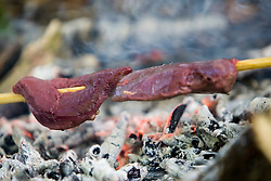 Patrick McGlinchey, founder and chief instructor of Backwoods Survival School, at Cambuslang. Backwoods' aim is to teach students not only how to survive, but to thrive in the natural environment - as our ancestors did and as many indigenous peoples still do. A pigeon's breast meat being prepared for lunch..Pic ©2010 Michael Schofield. All Rights Reserved.
