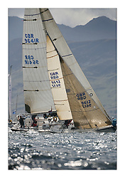 Sailing - The 2007 Bell Lawrie Scottish Series hosted by the Clyde Cruising Club, Tarbert, Loch Fyne..Brilliant first days conditions for racing across the three fleets..Class four's Bambi GBR9612 and Class one's Local Hero GBR9641R with the sun and hills around Loch Fyne..