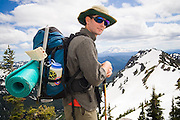 Dallas Anderson with a view of Mount Adams on a backpacking trip to Goat Lake in Goat Rocks Wilderness, Washington.