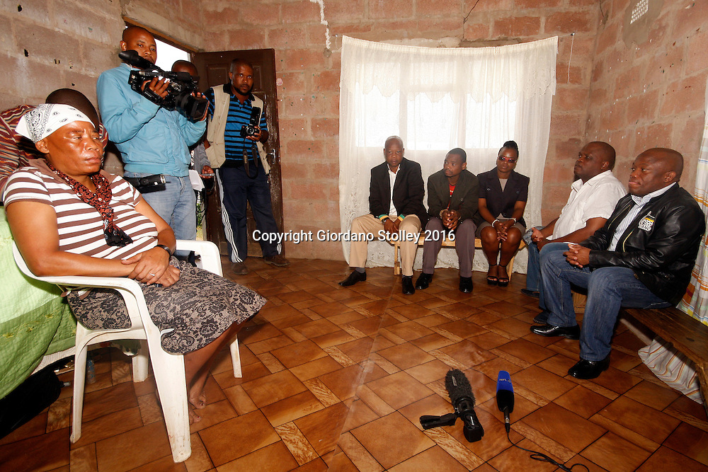 INCHANGA - 4 February 2016 - Barbara Dlamini (left) listens as Sihle Zikalala (right), chairman of the African National Congress (ANC) in KwaZulu-Natal expresses his condolences over the death of her husband Philip Dlamini, who was gunned down two weeks earlier at an SA Communist Party (SACP) meeting in Fredville, Inchanga. Looking on (seated) are other senior members of the ANC and SACP while the press records the meeting. Tensions between the ANC and its traditional partners, the SACP, have been high in the area, with SACP members accusing the ANC of preventing them from participating in nominations for the upcoming local government elections. Picture African News Agency. Picture: Allied Picture Press/APP