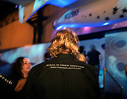 The back of  famous greying-blonde head belonging to Sir Richard Branson of Virgin Galactic is seen during SpaceShipTwo's replica model unveiling at the New York Wired NextFest at the Jacob K. Javits Convention Center. Galactic. Under construction by Burt Rutan in Mojave, California and looking more like '2001 A Space Odyssey,' than future everyday holidays, SpaceShipTwo is a re-usable orbiting vehicle that will become an important tool for Man's leisure time in space when affordable commercial space tourism starting in 2009/10. Aboard the space vehicle will be 6 passengers, each paying $200,000 for the 40 minute flight to 360,000 feet (109.73km, or 68.18 miles) and to experience 6 minutes of weighlessness.