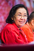 "23 FEBRUARY 2014 - NAKHON RATCHASIMA (KORAT), NAKHON RATCHASIMA, THAILAND: TIDA TAWORNSETH, president of the UDD, at the UDD meeting in Korat. The United front of Democracy against Dictator (UDD or Red Shirts), which supports the elected government of Yingluck Shinawatra, staged the ""UDD's Sounding of the Battle Drums"" rally in Nakhon Ratchasima (Korat) to counter the anti-government protests that have gripped Bangkok since November. Around 4,000 of UDD's regional and provincial coordinators along with the organization's core members met at Liptapunlop Hall inside His Majesty the King's 80th Birthday Anniversary Sports Complex in Korat to discuss the organization's objectives and tactics against anti-government protestors, which the UDD says ""seek to destroy the country's democracy."" The UDD leadersa announced that they will march to Bangkok and demonstrate against anti-government protests led by Suthep Thaugsuban.   PHOTO BY JACK KURTZ"
