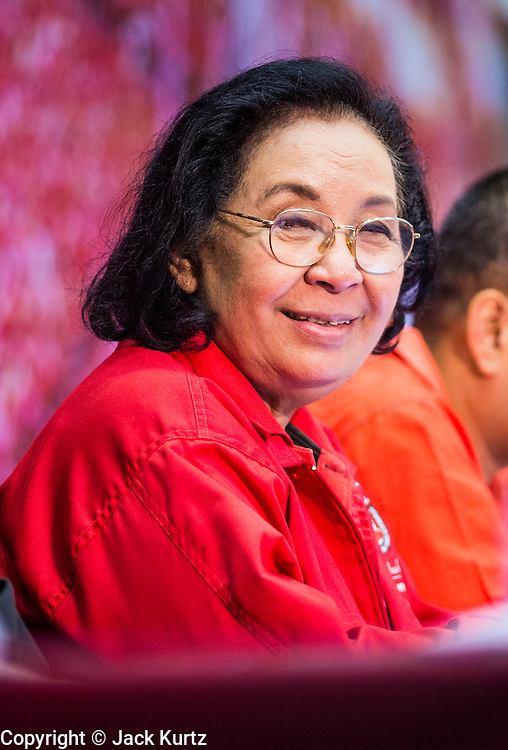 """23 FEBRUARY 2014 - NAKHON RATCHASIMA (KORAT), NAKHON RATCHASIMA, THAILAND: TIDA TAWORNSETH, president of the UDD, at the UDD meeting in Korat. The United front of Democracy against Dictator (UDD or Red Shirts), which supports the elected government of Yingluck Shinawatra, staged the """"UDD's Sounding of the Battle Drums"""" rally in Nakhon Ratchasima (Korat) to counter the anti-government protests that have gripped Bangkok since November. Around 4,000 of UDD's regional and provincial coordinators along with the organization's core members met at Liptapunlop Hall inside His Majesty the King's 80th Birthday Anniversary Sports Complex in Korat to discuss the organization's objectives and tactics against anti-government protestors, which the UDD says """"seek to destroy the country's democracy."""" The UDD leadersa announced that they will march to Bangkok and demonstrate against anti-government protests led by Suthep Thaugsuban.   PHOTO BY JACK KURTZ"""