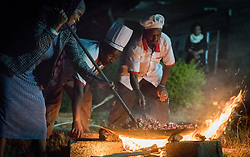 31 January 2019, Southern Nations, Nationalities, and Peoples' Region, Ethiopia: Chefs at the Hossana school for the deaf, run by the Ethiopian Evangelical Church Mekane Yesus, make food over a fire.