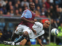 Credit: Back Page Images. Aston Villa v Fulham, FA Premiership, 23/10/2004. Darius Vassell (Aston Villa) wrestles for the ball with Zesh Rehman (Fulham)