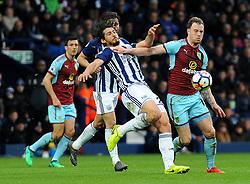 Ahmed Hegazy of West Bromwich Albion battles with Ashley Barnes of Burnley - Mandatory by-line: Nizaam Jones/JMP - 31/03/2018 - FOOTBALL - The Hawthorns - West Bromwich, England - West Bromwich Albion v Burnley  - Premier League