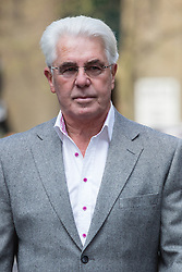 LNP Weekly Highlights 28/03/14  @Licensed to London News Pictures. 27/03/2014. London, UK. Publicist, Max Clifford arrives at Southwark Crown Court in London on 27th March 2014. Clifford is charged with 11 counts of indecent assault after being arrested as part of the Metropolitan Police's Operation Yewtree. Photo credit: Vickie Flores/LNP.