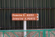 Signs in the village Condrieu pointing to Domaine R Niero and A Porte  Condrieu, Rhone, France, Europe