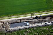 Nederland, Zeeland, St. Philipsland, 12-06-2009; Zeedijk van de Anna Jacobapolder met de Krammer. Detail dijkverbetering: op de klei die de bekleding van het dijklichaam vormt wordt doek aangebracht waarop steenslag gestort wordt. Daar weer bovenop komen de stenen. Aan de waterlijn, hier de grens met de schorren bij eb, liggen basaltblokken om de golfslag te breken. .Swart collectie, luchtfoto (25 procent toeslag); Swart Collection, aerial photo (additional fee required).foto Siebe Swart / photo Siebe Swart
