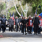Members of the National Socialist Movement,including Southwestern Regional Director, Jeff Russell Hall, front right with American flag, a Neo Nazi group, rallies in Claremont, California against illegal immigration. Please contact Todd Bigelow directly with your licensing requests.