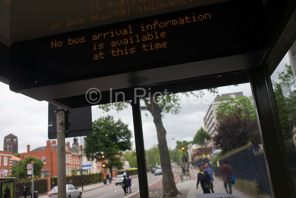 Denmark Hill, London 22/6/12. An unhelpful dot matrix information sign for non-existant passengers inside a bus shelter on Southwark's Denmark Hill. Inconvenienced commuters have had to seek alternative modes of transport on this day when the bus drivers' union called their first industrial action for 30 years, seeking a bonus of £500 for their work during the forthcoming Olympics. London's buses carry 6.5 million passengers every day with the capital's infrastructure relying on reliable travel.