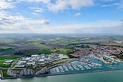 Nederland, Zeeland, Zeeuws-Vlaanderen, 19-10-2014; haven Breskens (Vissershaven, Handelshaven, jachthaven). De hoogbouw flats aan zee zijn vakantieappartementen - Port scaldis (Roompot vakanties)<br /> Harbours in Breskens.<br /> luchtfoto (toeslag op standard tarieven);<br /> aerial photo (additional fee required);<br /> copyright foto/photo Siebe Swart