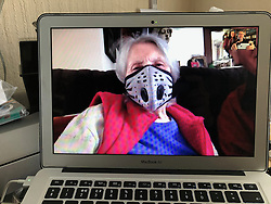 Photographer's 90 year old mother showing off her new face mask on a Facetime call during Coronavirus lockdown. UK 2020. MR