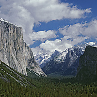 A fall snowstorms clears over Yosemite Valley, seen from Tunnel View.