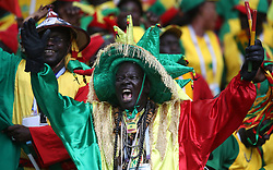 Senegal fan cheering during the game