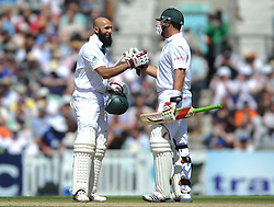 South Africa's Hashim Amla celebrates his 250 with team-mate Jacques Kallis during the Investec first test match at the Kia Oval, London.