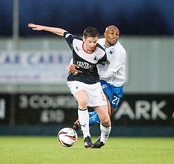 Falkirk's Conor McGrandles held by Morton's Fouad Bachirou.<br /> Falkirk 1 v 1 Morton, Scottish Championship game today at The Falkirk Stadium.<br /> © Michael Schofield.