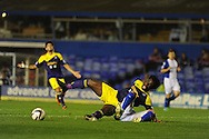 Swansea city's Wilfried Bony is sent flying by Birmingham's Paul Robinson but no penalty is awarded. Capital one cup 3rd round match, Birmingham city v Swansea city at St.Andrews in Birmingham on Wed 25th Sept 2013. pic by Andrew Orchard, Andrew Orchard sports photography.