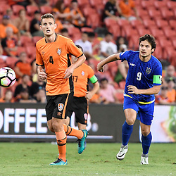BRISBANE, AUSTRALIA - JANUARY 31: Daniel Bowles of the Roar and Misagh Bahadoran of Global FC in action during the second qualifying round of the Asian Champions League match between the Brisbane Roar and Global FC at Suncorp Stadium on January 31, 2017 in Brisbane, Australia. (Photo by Patrick Kearney/Brisbane Roar)