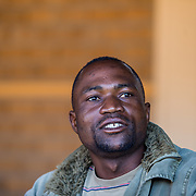 INDIVIDUAL(S) PHOTOGRAPHED: Albert Chama. LOCATION: Build It Centre of Excellence, Lusaka, Zambia. CAPTION: Albert Chama at the Build It Centre of Excellence in Lusaka, Zambia. Albert completed his bricklaying training at the Centre with Build It International, a charity that trains unemployed young people in Zambia to become builders, while at the same time building vital schools and clinics in communities with little or nothing by way of resources.