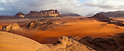 Red sand desert and sandstone cliffs in Wadi Rum, Jordan.