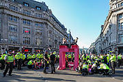 Protest Removal Unit of the Police working to remove protestors from the pink structure that was erected by Extinction Rebellion activists during the group's 'Impossible Rebellion' series of actions at Oxford Circus in central London, on Wednesday, August 25, 2021. - Climate change demonstrators from environmental activist group Extinction Rebellion continued with their latest round of protests in central London, promising two weeks of disruption. (VX Photo/ Vudi Xhymshiti)