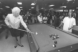 First Lady Barbara Bush plays pool with 12-year-old Tyrone Darden at the East Branch of the Boys & Girls Clubs of San Antonio on Feb. 26, 1992. Tyrone said later he thought he was playing with Texas Gov. Ann Richards. <br />
