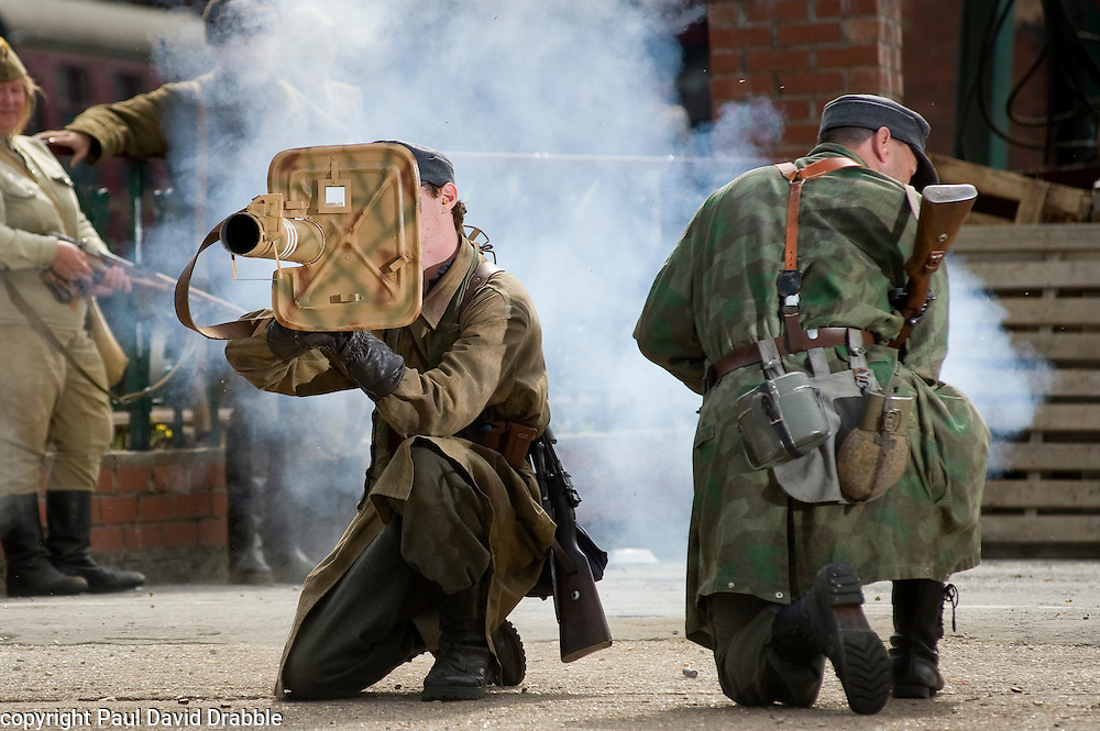 """Reenactors from Northern World War Two Association, portraying a members of the 1st Fallschirmjaeger Division 'The Green Devils' take part in a firing display with a Panzerschreck or """"tank terror"""" at Elsecar 1940s Weekend<br /> 4 September 2010<br /> Images © Paul David Drabble"""