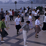 China, Cities, City of Shanghai. Residents doing morning exercises at Huang Pu River.
