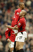 Photo. Aidan Ellis.<br />Manchester United v Tottenham Hotspur.<br />FA Barclaycard Premiership.<br />20/03/2004.<br />United's David Bellion celebrates his goal and teams third with Mikkael Silvestre