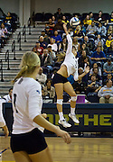 Northern Arizona's Senior Janae Vander ploeg, Outside Hitter, puts all of her power into this spike to edge closer of taking the lead against Northern Colorado during the fifth and final set, Oct. 24, 2015. NAU would start the set being down 4-1, but would win 15-13. (Photo by David Carballido-Jeans)