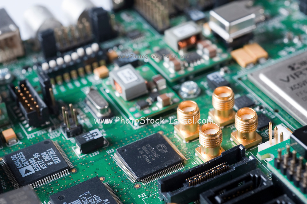 Close up of an electronic circuit board. Electronic waste from Old Computers, is a major concern to ecologists around the world as they contain heavy metals and other poisonous materials