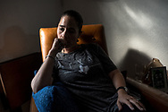 Adria Rodriguez, 37, of El Paso, poses for a portrait inside her brother's home in El Paso, Texas, Monday, August 5, 2019. Rodriguez and her mother were inside the Cielo Vista Walmart when a gunman opened fire on customers on Aug. 3 fatally shooting 22 people and injuring dozens more. Rodriguez waved a hat she was wearing, flagging down shoppers and guiding them toward an exit to safety.