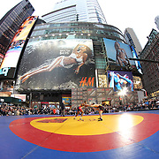 Jordan Burroughs, (left), USA, in action against  Atsamaz Sanakoev, Russia, during the 'Beat The Streets' USA Vs The World, International Exhibition Wrestling in Times Square. New York, USA. 7th May 2014. Photo Tim Clayton