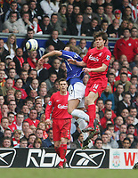 Photo: Andrew Unwin.<br />Liverpool v Everton. The Barclays Premiership. 25/03/2006.<br />Liverpool's Xabi Alonso (R) is elbowed by Everton's Andy Van Der Meyde (C).