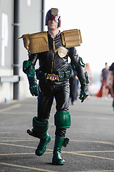 © Licensed to London News Pictures. 25/05/2018. LONDON, UK.  A cosplayer as Judge Dredd attends MCM Comic Con at Excel in East London.   Thousands of fans of video games, comic books and other popular character take the opportunity to dress up as their favourite characters.  Photo credit: Stephen Chung/LNP