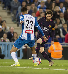 BARCELONA, April 30, 2017  Barcelona's Lionel Messi(R) vies with Espanyol's Diego Reyes during the Spanish first division (La Liga) soccer match between RCD Espanyol and FC Barcelona at RCDE Stadium in Barcelona, Spain, April 29, 2017. Barcelona won 3-0. (Credit Image: © Lino De Vallier/Xinhua via ZUMA Wire)
