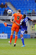 Cardiff City's Kagisho Dikgacoi (r) clears from Ipswich's Daryl Murphy (9). Skybet football league championship match, Cardiff city v Ipswich Town at the Cardiff city stadium in Cardiff, South Wales on Saturday 12th March 2016.<br /> pic by Carl Robertson, Andrew Orchard sports photography.