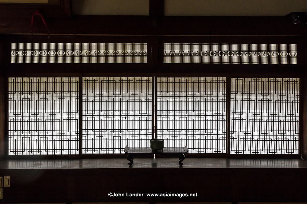 Shoji Paper Windows-  In traditional Japanese architecture, a shoji is a door, window or room divider made of translucent paper over a frame of wood or bamboo. While washi is the traditional paper, shoji can also be made of modern paper.  Shoji doors are designed to slide open, and conserve space that would be required by a swinging door.  Shoji also provide a form of insulation in winter, keeping drafts out.  They are used in traditional houses in the washitsu or Japanese-style tatami room and almost all temples would have them in abundant use.  Shoji paper needs to be changed regularly as they collect dust and become discolored over time.  Normally this is done in late autumn each year.  However, modern Japanese will only change the shoji paper when they become too discolored for comfort, or have holes appearing in them.  It is a long, tedious process that most people wish to avoid.
