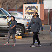 Special Olympics athlete Delilah Maria of Ramah carries the Special Olympics torch for the Law Enforcement Torch Run on Route 66 Saturday morning in Gallup. Maria is accompanied by her mother Rachel Martin, center, and grandmother Effie Martin.