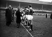 The President of Ireland, Sean Thomas O'Kelly, greeting N A Murphy, Cork Constitution, ..Irish Rugby Football Union, Ireland v England, Five Nations, Landsdowne Road, Dublin, Ireland, Saturday 14th February, 1959,.14.2.1959, 2.14.1959,..Referee- D Gwynne Walters, Welsh Rugby Union, ..Score- Ireland 0 - 3 England, ..Irish Team, ..N J Henderson, Wearing number 15 Irish jersey, Full back, N.I.F.C, Rugby Football Club, Belfast, Northern Ireland,..N H Brophy, Wearing number 14 Irish jersey, Right wing, University College Dublin Rugby Football Club, Dublin, Ireland, ..A J O'Reilly, Wearing number 13 Irish jersey, Right Centre, Old Belvedere Rugby Football Club, Dublin, Ireland, and, Leicester Rugby Football Club, Leicester, England, ..J F Dooley, Wearing  Number 12 Irish jersey, Left Centre, Galwegians Rugby Football Club, Galway, Ireland, ..A C Pedlow, Wearing number 11 Irish jersey, Left wing,  C I Y M S Rugby Football Club, Belfast, Northern Ireland, ..M A English, Wearing number 10 Irish jersey, Outside Half, Bohemians Rugby Football Club, Limerick, Ireland,..A A Mulligan, Wearing number 9 Irish jersey, Scrum Half, London Irish Rugby Football Club, Surrey, England, ..B G Wood, Wearing number 1 Irish jersey, Forward, Garryowen Rugby Football Club, Limerick, Ireland, ..A R Dawson, Wearing number 2 Irish jersey, Captain of the Irish team, Forward, Wanderers Rugby Football Club, Dublin, Ireland, ..S Millar, Wearing number 3 Irish jersey, Forward, Ballymena Rugby Football Club, Antrim, Northern Ireland,..W A Mulcahy, Wearing number 4 Irish jersey, Forward, University College Dublin Rugby Football Club, Dublin, Ireland, ..M G Culliton, Wearing number 5 Irish jersey, Forward, Wanderers Rugby Football Club, Dublin, Ireland, ..N A Murphy, Wearing number 6 Irish jersey, Forward, Cork Constitution Rugby Football Club, Cork, Ireland,..P J A O' Sullivan, Wearing  Number 7 Irish jersey, Forward, Galwegians Rugby Football Club, Galway, Ireland,..J R Kavanagh, Wearing number 8 Irish